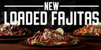Shrimp, Chicken, and Sirloin Loaded Fajitas served on a sizzling hot skillet