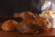 Church's Bourbon Black Pepper Smokehouse Chicken with a side and a biscuit