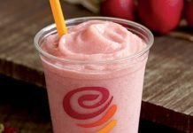 Jamba Juice Red Smoothie with a strawberry next to it