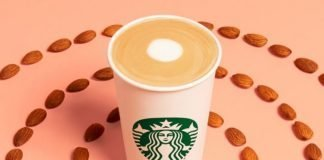 Starbucks new Almondmilk Honey Flat White surrounded by circles of almonds